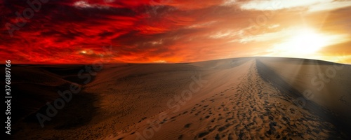 Canvas Print Night in the desert sand dunes. Desert against a dramatic red sky