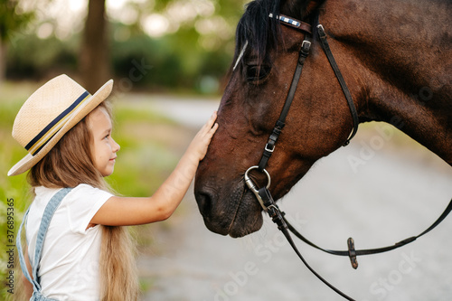 Fotografie, Tablou Friendship of a child with a horse