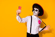 canvas print picture - Portrait of his he nice handsome painted spooky guy caballero taking making selfie calavera celebration look outfit having fun isolated bright vivid shine vibrant yellow color background