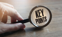Magnifying Glass With Text KEY POINTS On Wooden Table