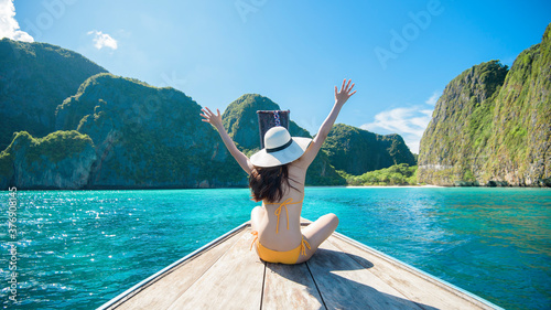 View of woman in swimsuit enjoying on thai traditional longtail Boat over beauti Fototapeta