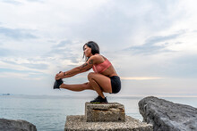 Fitness Woman Doing Pistol Squat Outdoors.