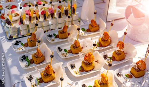 Luxury food on wedding table Poster Mural XXL