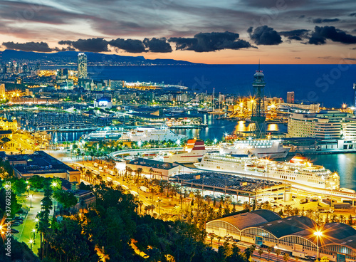Aerial view of the port of Barcelona illuminated at sunrise Canvas Print