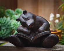 Wooden Statue Of A Bear Reading A Book
