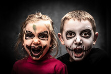 Children With Face Made Up For Halloween Party.