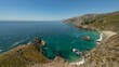 Timelapse overview of blue green ocean at rugged coastline in Central California