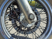 Close Up Of A Classic Motorcycle Front Wheels