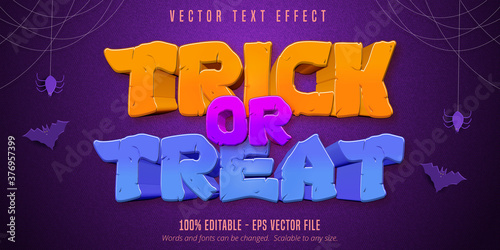 Fototapeta Trick or treat text,  halloween style editable text effect on purple textured background obraz