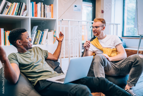 Fotografija Black guy telling story to male colleague