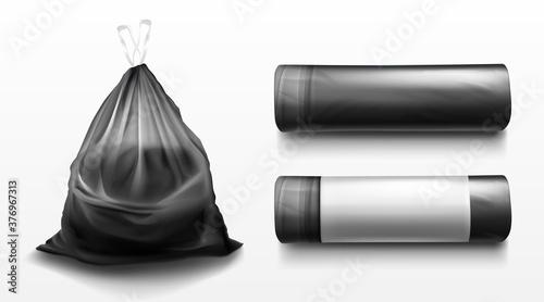 Photo Black plastic bag for trash, garbage and rubbish