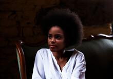 Black Woman Resting On Green V...