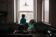 Young Boy And Girl Staring Out...