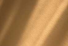 Diagonal Natural Shadow Overlay Effect On A Textured Rough Surface Toned In Honey Dijon Color.Window Shadow Concept For Background, Product Presentation, Mockup, Photo, Posters And Wallpapers.