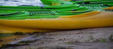 Professional Sports Kayak Lies On The River Bank