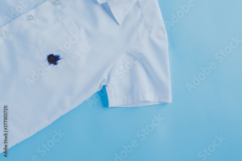 Obraz ink stain on shirt pocket.daily life dirty stain for wash and clean concept - fototapety do salonu