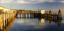 Dock In Bodega Bay, California, Reflecting In Calm Water Near Sunset
