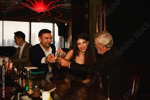 businesspeople toasting glasses of whiskey to celebrate friendship