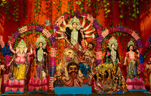 Durga Puja Or Durgotsava,is An Annual Hindu Festival Celebrated Mainly In West Bengal,India.Durga Is Goddess Riding A Lion With Many Arms Each Carrying Weapons And Defeating Evil Power Of Mahishasura.