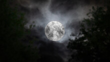 Full Moon Behind The Clouds An...