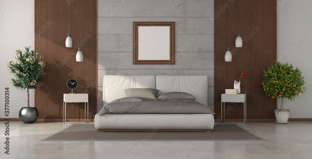 Modern bedroom with double bed against concrete wall