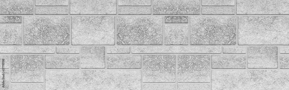Fototapeta Panorama of Block pattern of white stone cladding wall tile texture and seamless background
