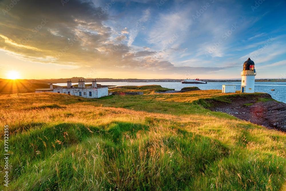 Fototapeta Stunning sunset over Arnish Point and it's lighthouse overlooking Stornoway harbour