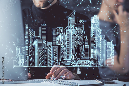 High tech city drawing with businessman working on computer on background Canvas Print