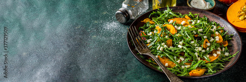 Tela Homemade pumpkin salad with grilled pumpkin slices, arugula and cheese
