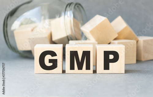 Photo GMP - abbreviation of Good Manufacturing Practice concept on cubes