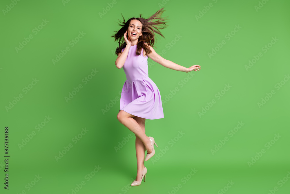 Fototapeta Full length body size view of her she nice-looking attractive pretty charming lovely carefree cheerful cheery girl having fun enjoying free time dancing air blowing isolated green color background