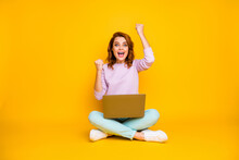Full Body Photo Ecstatic Excited Funy Woman Sit Legs Crossed Work Laptop Win Online Lottery Raise Fists Scream Yeah Wear Turquoise Pink Pullover Pants Sneakers Isolated Yellow Color Background
