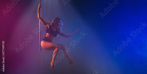 Pole dance woman on a dark, colorful background Canvas