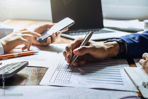 businessman working in office with using a calculator to calculate the numbers finance accounting concept