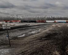 Railroad Cars With Graffiti On Them.