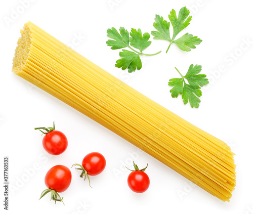 Fotografie, Obraz Raw pasta with tomatoes and herbs on a white background, isolated