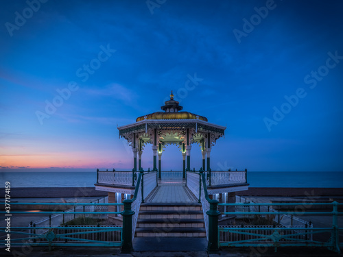 A spectacular dawn rises behind the bandstand on Brighton seafront Canvas Print