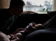 Father And Baby At Home