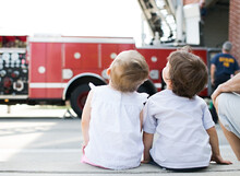 Kids Look At Fire Truck Ladder