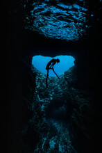 A Female Free Diver Diving In ...