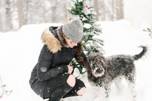 Teen Girl With Dog In The Snow