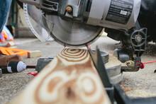 Saw Cutting 2x4 Piece Of Wood
