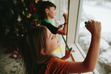 Kids Write On Window With Mark...