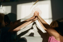 Children Make Shadow Puppets With Hands