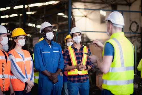 A team of technicians, foreman and engineers Accepting assignments from a manage Canvas Print