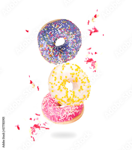Fotografia, Obraz Fresh colored donuts isolated on white background