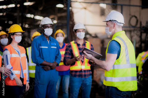 The manager or leader team is assignmenting a job for team of technicians, super Canvas Print