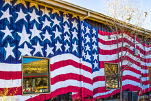 Tin Building With American Flag Painted On Side