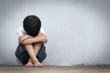 A Boy Sitting Alone With Sad F...