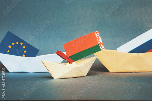 paper boat with the flag of belarus  and russia,  europe. Canvas Print
